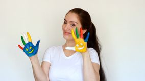 Girl smiling and showing painted dirty hands with smiles. The concept of happiness, good mood and joy.  stock footage