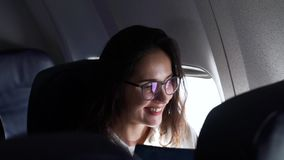 Girl smiling while sitting in the plane.  stock video