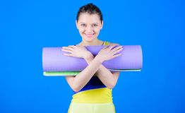 Girl smiling slim fit athlete hold fitness mat. Fitness and stretching. Stretching muscles. Getting into the yoga groove. Yoga as hobby and sport. Yoga class stock photos
