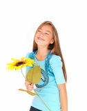 Girl smiling with sunflower. Royalty Free Stock Image
