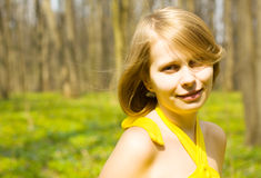 Girl smiling in sunny spring field. Copy space Stock Photo