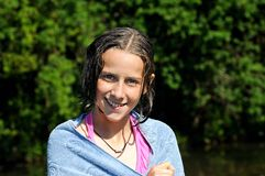 Girl smiling after a swim Royalty Free Stock Photography