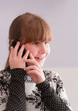Girl smiling and talk on telephone Royalty Free Stock Photo