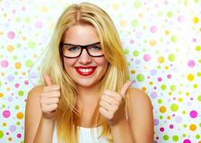 Girl smiling with thumbs up Royalty Free Stock Image