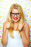 Girl smiling with thumbs up Royalty Free Stock Images