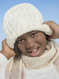Girl smiling under the winter sun Stock Photography