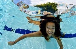 Girl Smiling Underwater Stock Photos