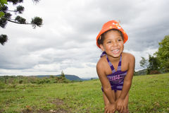 Girl Smiling And Using An Orange Hat Royalty Free Stock Photography