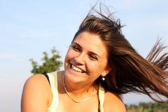 Girl smiling4. Beautiful cute smiling female having fun outdoor Stock Photography
