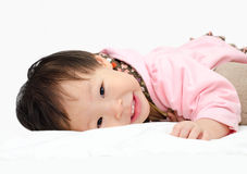 Girl  smilling on bed Stock Image