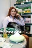 Girl and smoke aroma lamp Royalty Free Stock Photo