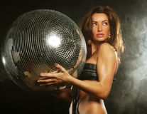 Girl in smoke with disco ball Royalty Free Stock Images