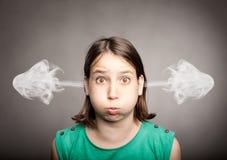 Girl with smoke on her ears Stock Photos