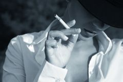 A girl smoking Royalty Free Stock Images