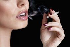 Girl smoking Royalty Free Stock Photos