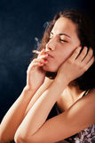 Girl smoking a cigarette Stock Photos