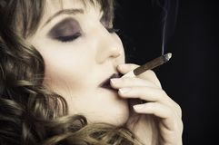 Girl smoking a cigarette Royalty Free Stock Photos