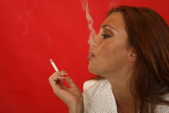 Girl smoking a cigarette Royalty Free Stock Images