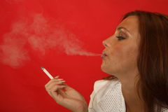 Girl smoking a cigarette Stock Photography