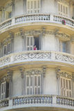Girl smoking cigarette on balcony of apartment, Nice, France Stock Photography