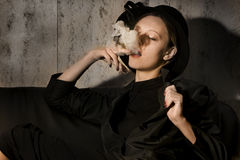 Girl smoking cigarre Stock Images