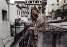 Girl smoking on the roof Stock Photography