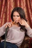 Girl smoking turkish shisha in cafe Royalty Free Stock Photography