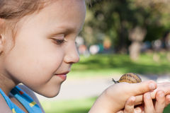 A girl with a snail royalty free stock images