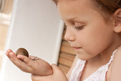 Girl with snail Stock Images