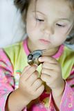 Girl and snail Royalty Free Stock Photos
