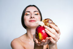 A girl with a snail on the apple Royalty Free Stock Images