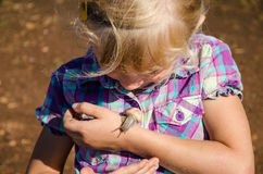 Girl with snail. Little girl watching snails on her hand Royalty Free Stock Image