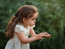 Girl with a snail Stock Photos