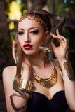 Girl and snake Stock Photo