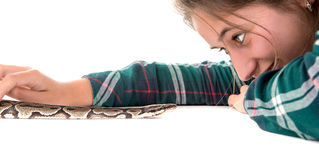 Girl with snake. Girl playing with a snake isolated in white stock image