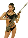 Girl with snake and rifle Royalty Free Stock Photos