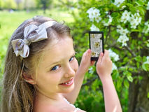 Girl snapshot blossoming tree Stock Photos