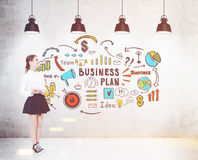 Girl in sneakers and business plan, toned Royalty Free Stock Photo