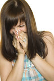 Girl sneezing Royalty Free Stock Photo