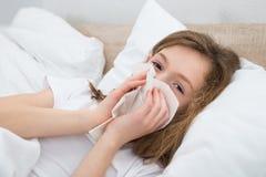 Girl Sneezing In Handkerchief Stock Images