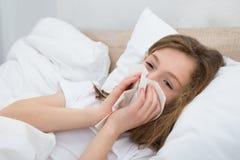 Girl Sneezing In Handkerchief Stock Photography