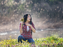 Girl sneezing on meadow Royalty Free Stock Image