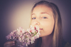 Girl sniff cherry blossoms, grain effect Royalty Free Stock Photography