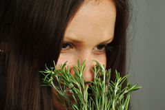 Girl sniffing rosemary Stock Photo