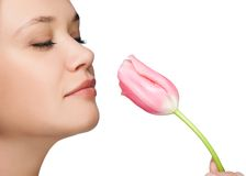 Girl  sniffing tulip portrait Royalty Free Stock Image