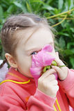 Girl Sniffs a Flower Stock Photo