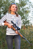 Girl with a sniper rifle Stock Photography