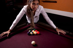 Girl on a snooker table Royalty Free Stock Photo