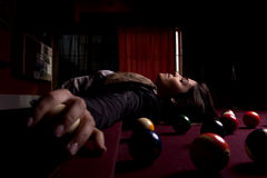 Girl on a snooker table Stock Photo
