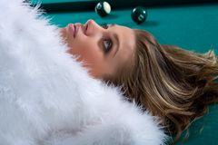 Girl on snooker table Royalty Free Stock Photo